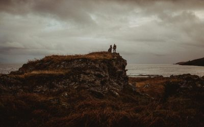 bride and groom on top of a hill in the isle of jura